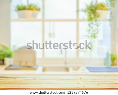 Wood table top on blurred kitchen background, #1239274576
