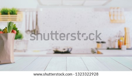 Wood table top on blurred kitchen background,