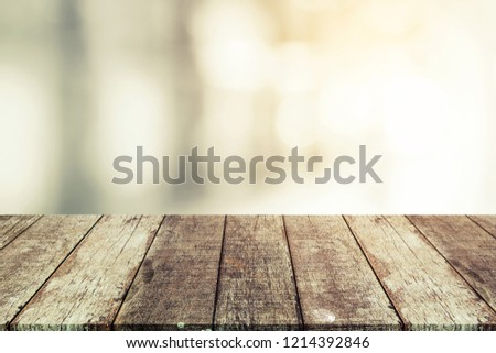 Wood table top on shiny bokeh background -for display or montage your products