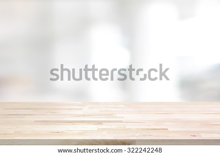 Wood table top on white blurred abstract background from building hallway  - can be used for display or montage your products