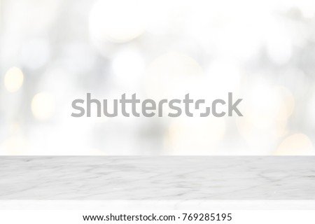 Wood table top on white bokeh abstract background and used for montage or display products