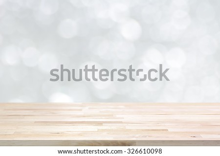 Wood table top on white bokeh abstract background - can be used for montage or display your products