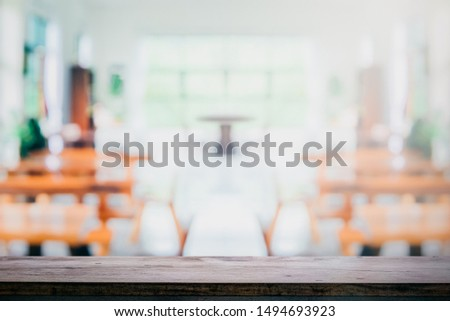 Wood Table Top Reception Counter or Cash Counter Restaurant or coffee cafe blurred background for montage product present
