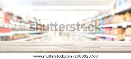 Wood table top with blur supermarket in background, panoramic banner - can be used for display or montage your products #1080823760