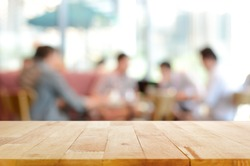 Wood table top with blurred people in cafe as background - can be used for montage or display your products