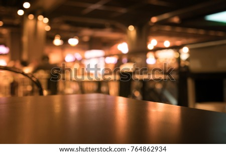 restaurant table top lighting. Wood Table Top With Reflect On Blur Of Lighting Bokeh In Night Cafe, Restaurant Background