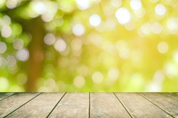 Wood Table with Beautiful Bokeh of Vineyard Background with Light Leak.