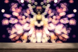 Wood table with colorful fireworks.bokeh blur