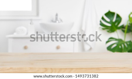 Wood tabletop on blur bathroom background, design key visual layout