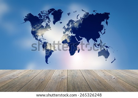 Wood terrace and blurred Blue sky background with world map