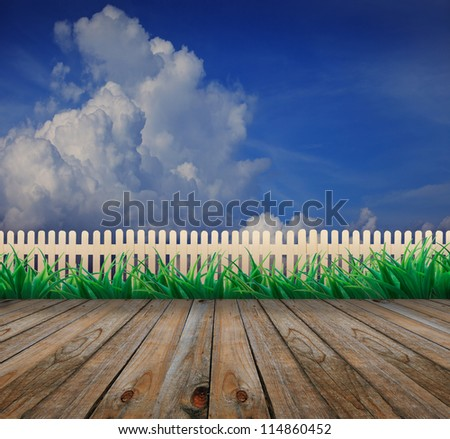 wood terrace and garden fence blue sky background