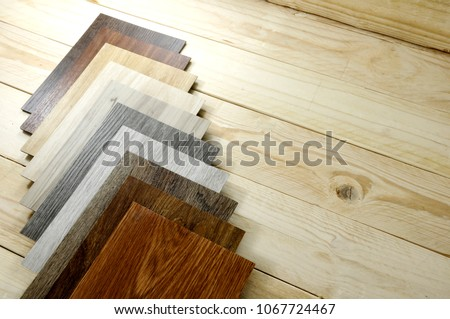 wood texture floor Samples of laminate and vinyl floor tile on oak wooden Background for new construction or renovate building or home renovate.