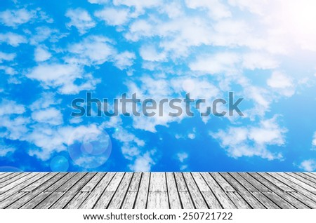 wood texture floor with  sunshine blue sky and cloud