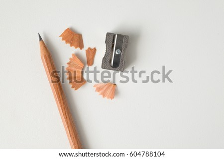 Wood texture pencil with sharpening shavings on white background #604788104