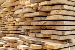 Wood timber stack of wooden blanks construction material. Logging Industry. Natural photo.