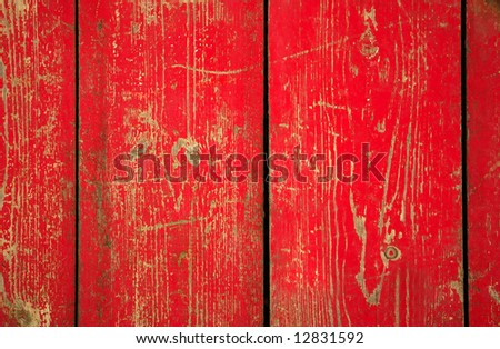 Wood with chipped red paint. Grunge style background