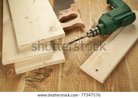 Wood work tools and planks. Including hand saw, drill,screws.
