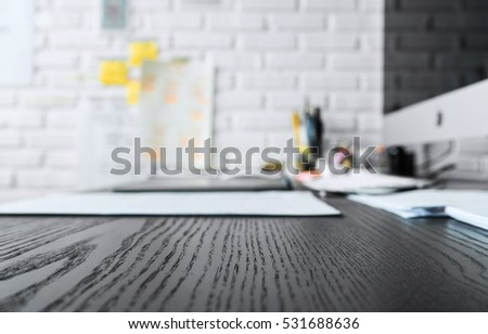Wood working table in black and computer with copy space top view.For table background ideas and business concept.