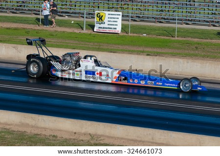WOODBURN, OR - SEPTEMBER 27, 2015: Capitol Auto Group dragster racing at the NHRA 30th Annual Fall Classic at the Woodburn Dragstrip.