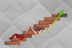 woode block stair with paper financial graph on flod paper background business ideas concept