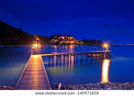 Wooded bridge in the port Twilight light
