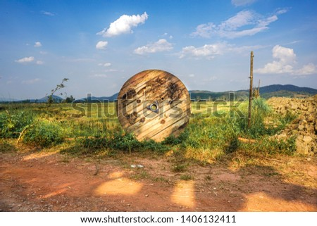 Wooded Cable reel in the field. #1406132411