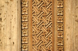 wooded door with symmetric carved pattern in Bali , Indonesia