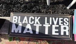 Wooded sign with words Black Lives Matter
