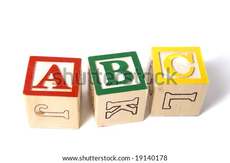 wooden ABC blocks on a white background