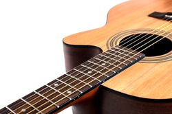 Wooden acoustic guitar isolated closeup horizontal