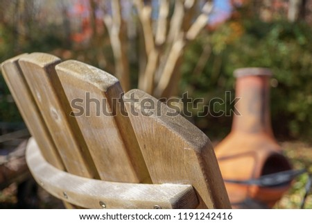 Wooden Adirondack chair and chiminea fireplace hangout