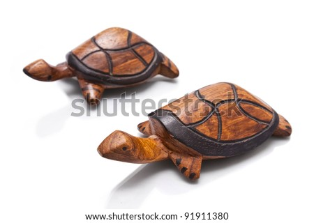 Wooden african turtles, isolated on white background