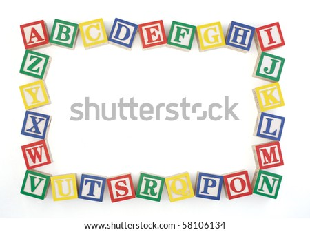 Wooden alphabet blocks arranged to create an horizontal frame isolated on a white background. Clipping path.