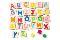Wooden alphabet blocks with letters on white background