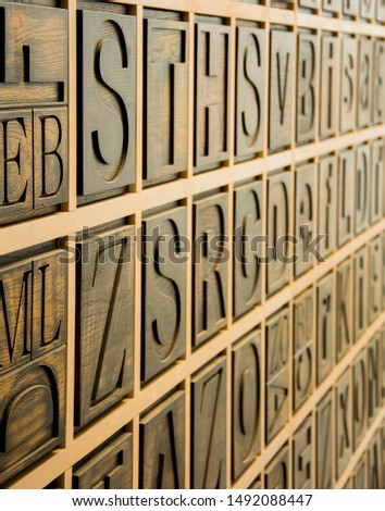 Wooden alphabetic wall in capital letters #1492088447