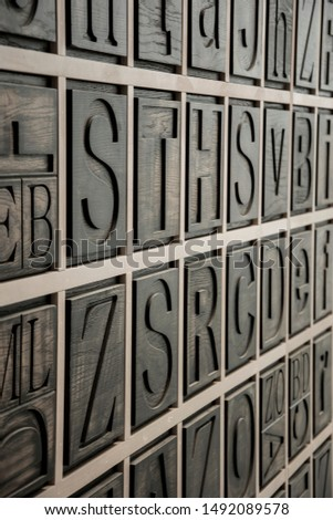 Wooden alphabetic wall in capital letters #1492089578