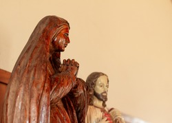 Wooden and ceramic statues from Maria and Jesus Christ, religious icons for the catholicism