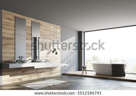 Wooden and dark gray bathroom corner with a white floor, a white tub, two toilets and a double sink. 3d rendering mock up