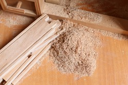 Wooden and Sawdust. Wood texture. Sawdust texture. Place for the text. In the workshop of the joiner. Shaving on the natural pine plank closeup.