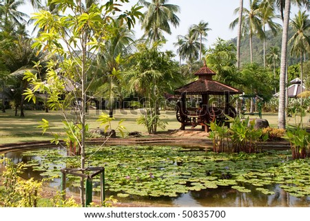 Wooden arbor and pond with flower