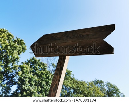 Wooden arrow (track blank, cursor,  road sign) with space for text #1478391194