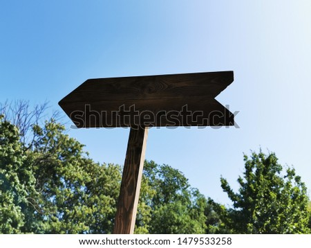 Wooden arrow (track blank, cursor,  road sign) with space for text #1479533258