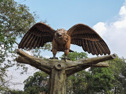 wooden art design king of the sky eagle carved in the wood artistically in the temple of lord rama devotee known as jatayu bird from the epic tale of Ramayana