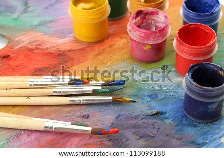 wooden art palette with paint and brushes, close up #113099188