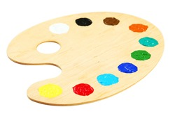 Wooden art palette with paints isolated on white