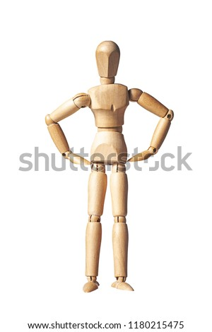 Wooden artist mannequin isolated on a white background with arms on hips