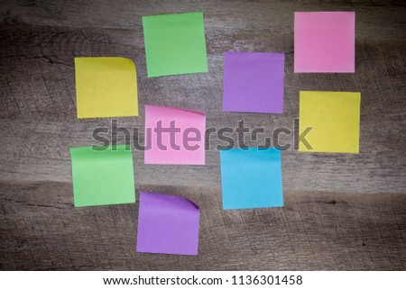 wooden background and filled with blank color notes #1136301458