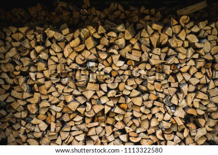 Wooden background. Firewood for the winter, stacks of firewood #1113322580