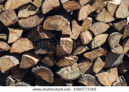Wooden background. Firewood for the winter, stacks of firewood, pile of firewood #1060772360