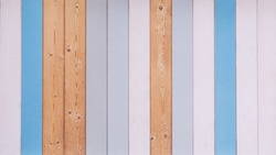 Wooden background made of varicoloured planks with natural texture.
